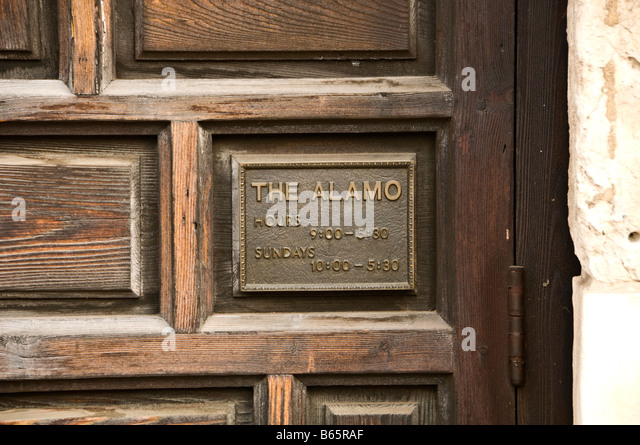 the alamo mission shrine monument marker at carved wood entrance door historic site memorial san antonio texas tx - Stock Image