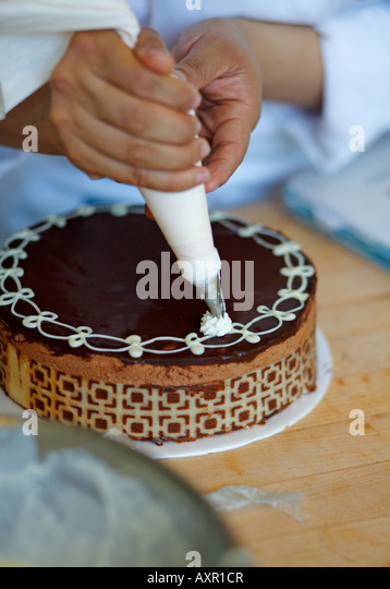 Cake Decorating Stock Images : Decorating Cake Piping Stock Photos & Decorating Cake ...