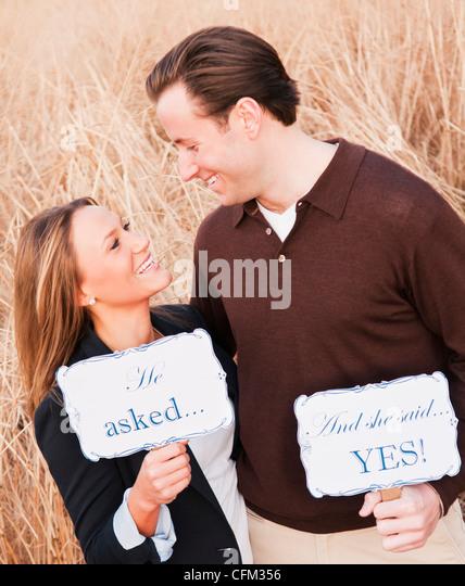 USA, New York, Long Island City, Young couple flirting on wheat field - Stock-Bilder