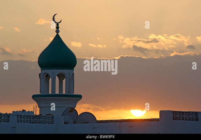 mosque architecture Oriental half moon crescent sun mood dusk twilight religion Islam Sur town city Oman - Stock Image