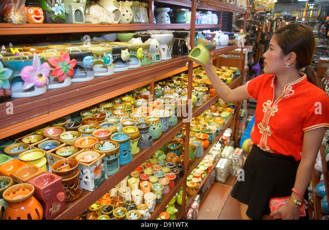 Bangkok Thailand Chatuchak Jatujak Weekend Market J.J. marketplace flea shopping Asian woman ceramic incense holders - Stock Image