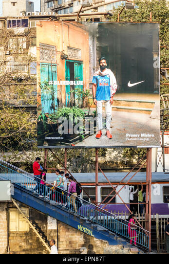 India Asian Mumbai Girgaon Maharshi Karve Road Charni Railway Station Western Line billboard advertisement Nike - Stock Image