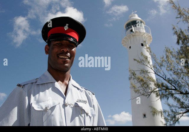 Turks and Caicos Grand Turk Lighthouse built 1852 North East Point Black male policeman - Stock Image