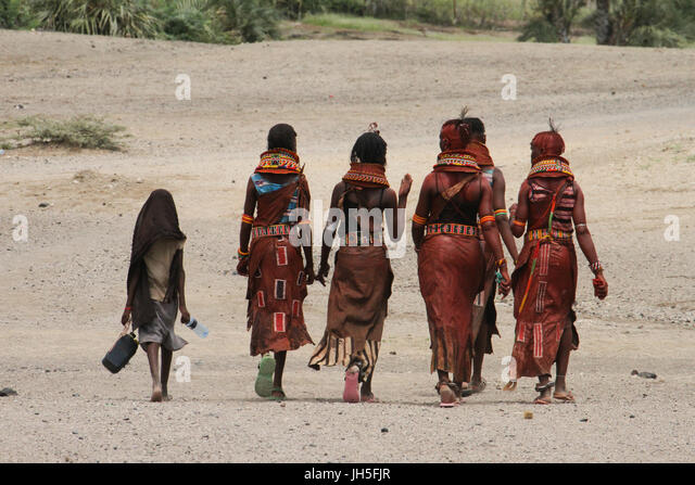 LOYANGALENI, KENYA. May 19. A group of Turkana women walk home after the rehearsals ahead of their Lake  Turkana - Stock Image