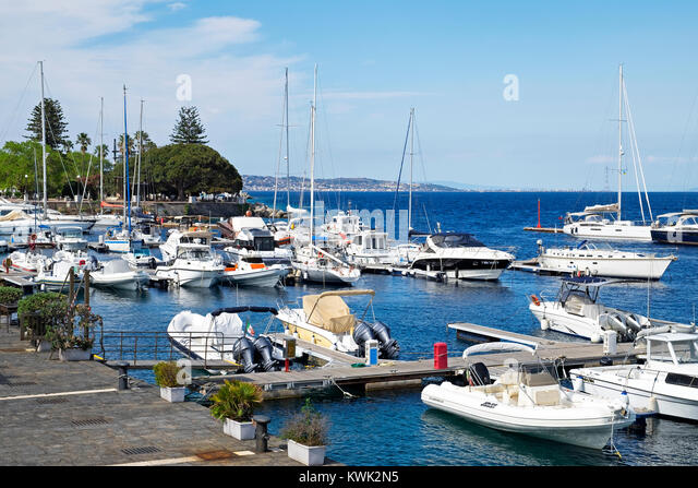 yachts and boats at the marina in the city of messina on the island of sicily, italy. - Stock Image