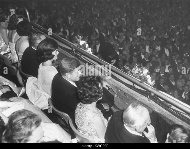 President John Kennedy and party seated in the National Guard Armory Inaugural Ball. Party includes: Lady Bird Johnson; - Stock Image