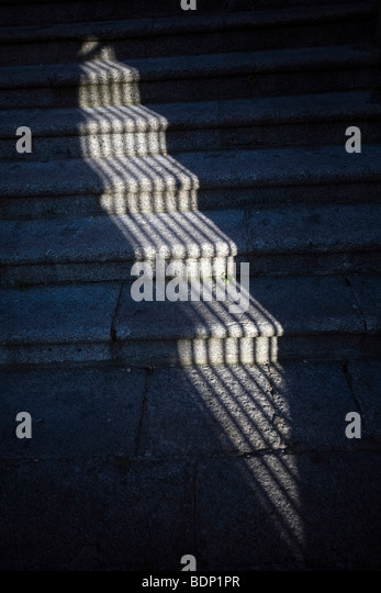 The shadow of a window grille on stone steps, Caceres, Spain - Stock-Bilder