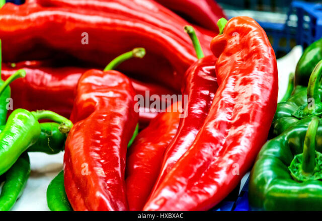 Red and green peppers - Stock Image