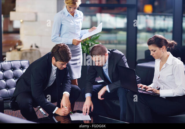 business people in a meeting at office - Stock Image