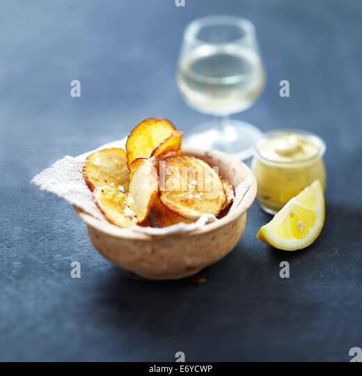 Potato crisps with lemon-flavored mustard - Stock Image