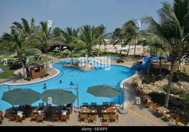 Swimming pool of the Hilton Hotel, Salalah, Dhofar Region, Orient, Oman - Stock Image