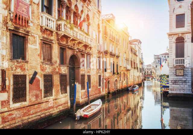 Gondolas on canal in Venice.  is a popular tourist destination of Europe - Stock Image