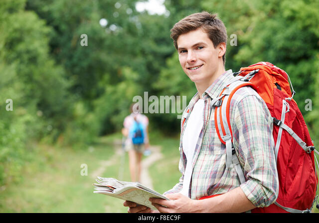 Young Couple Hiking In Countryside - Stock Image