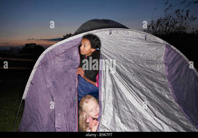 Girls in sleeping bags at dusk - Stock Image