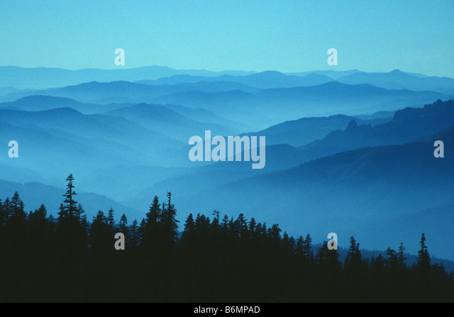 Mist-covered hills seen from the slopes of Mount Shasta, California - Stock Image