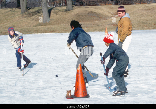 Ice Hockey Action Ages 9 to 15 - Stock Image