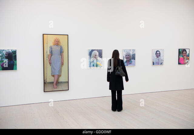 woman viewing exhibition at the saatchi gallery london - Stock Image