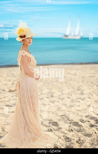 Victorian woman at the beach - Stock Image