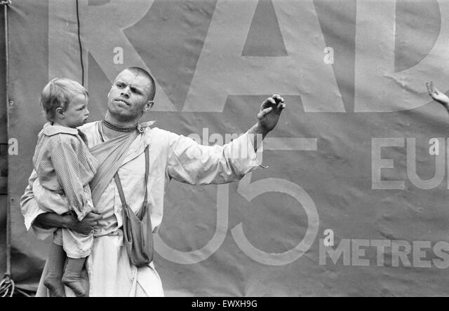 Father and son from the Indian Radha Krishna temple at the start of the Hollywood Music Festival opening the entertainment. - Stock Image