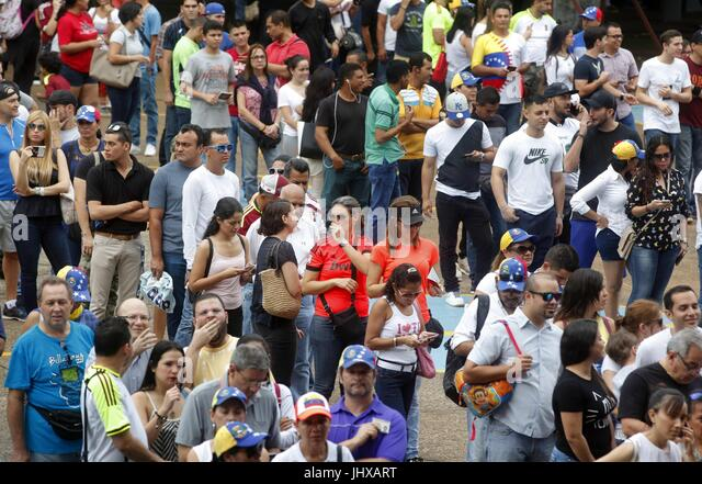 A group of Venezuelans living in Panama attend a polling place to participate in the popular consultation of the - Stock Image