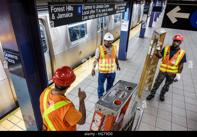 New York New York City NYC subway MTA public transportation train Queens Plaza station MTA worker ladder maintenance - Stock Image