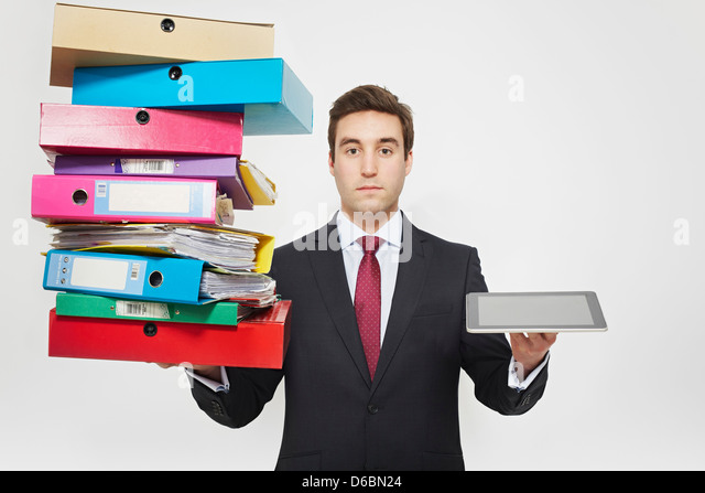 Businessman with stacks of folders and tablet computer - Stock-Bilder