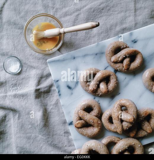 Homemade salted pretzels with egg wash - Stock Image