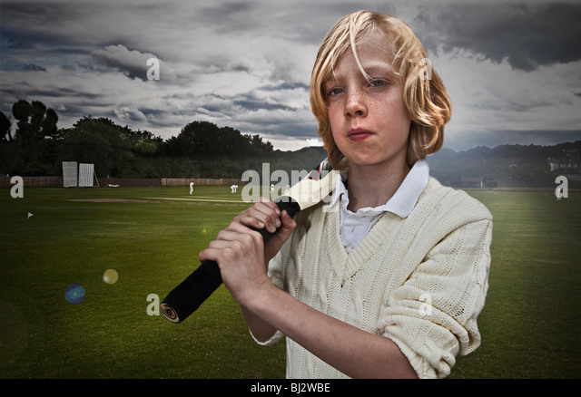 portrait, young male cricketer with bat - Stock Image
