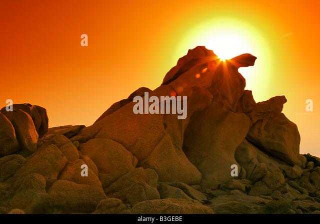 Italy Sardinia Capo Testa bizarre rock landscape sunset - Stock Image