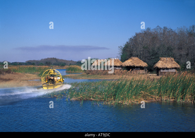 Florida fl airboat ride passing seminole indian chickee huts billie swamp safari attraction - Stock Image