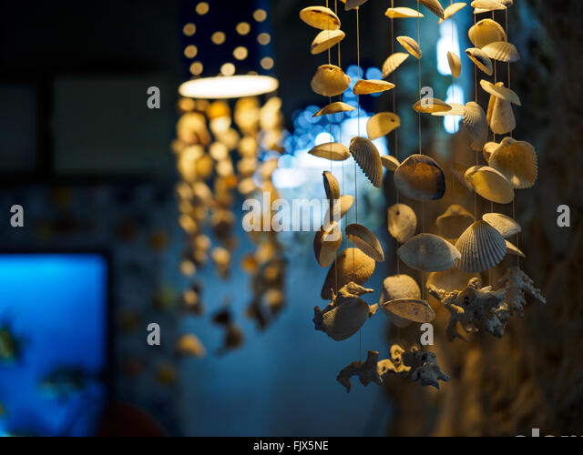 Low Angle View Of Wind Chimes Made From Seashells - Stock Image