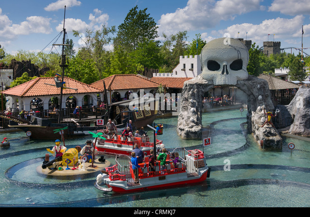 Water fights aboard Lego boats at Pirateland with skull gateway, Legoland, Billund, Denmark - Stock Image