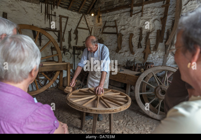 Wheelwright's demonstration at Acton Scott Historic Working Farm. Shropshire - Stock Image