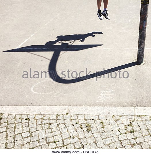 Shadow Of Man Playing Basketball On Court - Stock Image