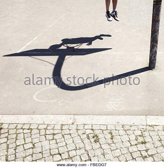 Shadow Of Man Playing Basketball On Court - Stock Image