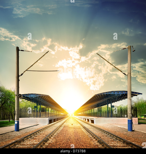 Railway station at sunset in the Sunlight - Stock Image