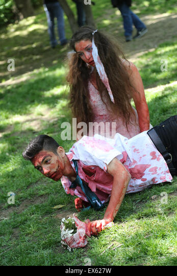 girl and boy wedding dresses during zombie walk Istanbul Nisantasi Park - Stock Image