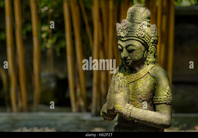 Stone statue in buddhist temple Mendut in Yogyakarta, Indonesia - Stock Image