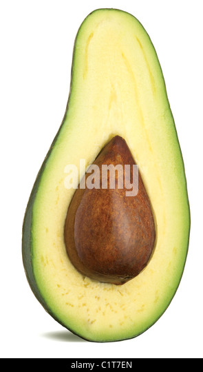 a half of an avocado with stone isolated on a white background with clipping path - Stock Image