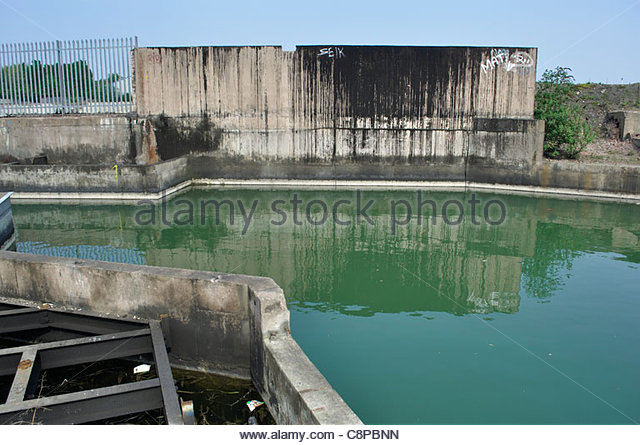 Contaminated industrial site: polluted water at site of former IMI copper works, Walsall. - Stock Image