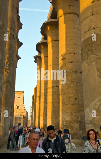 Luxor Temple Egypt twilight late afternoon crowd tourists tall iconic tall columns popular tourist attraction - Stock Image