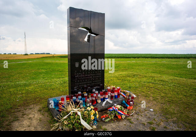 Memorial that marks the mass grave of the victims of  Vukovar massacre in the fields at Ovcara, near Vukovar, Croatia - Stock Image