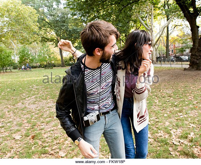 Happy young hipster couple fooling around in park - Stock-Bilder