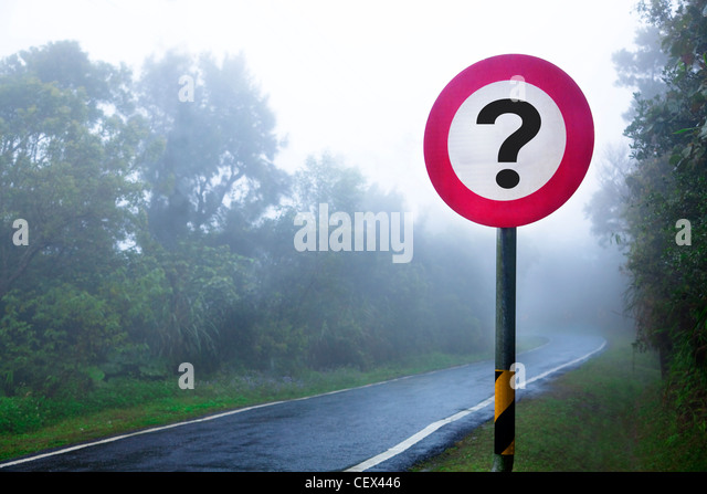 The road to the fog forest and question sign - Stock Image