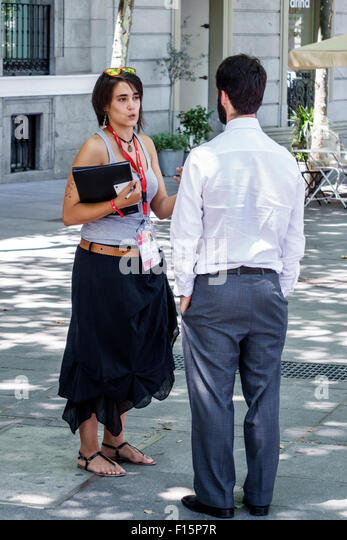 Madrid Spain Europe Spanish Centro Paseo del Prado Hispanic woman man survey soliciting donations Save the Children - Stock Image