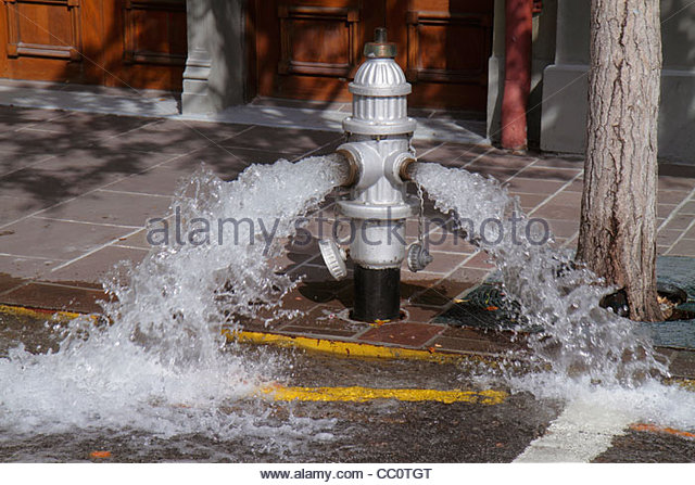 Louisiana New Orleans Warehouse District Julia Street fire hydrant fire protection measure open valve water flow - Stock Image