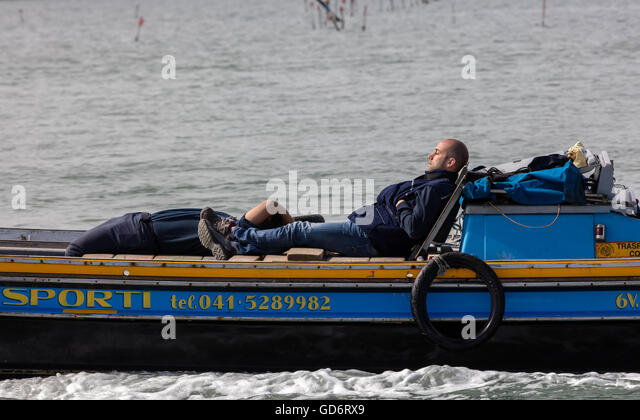 Workers sleeping on a transportation boat - Stock Image