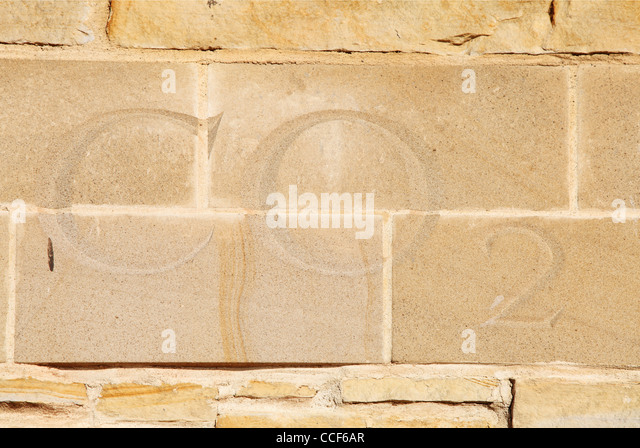 Carbon dioxide letters CO2 carved in stone old lime kilns Sunderland north east England UK - Stock Image