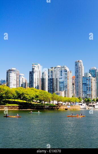 People canoeing near Ron Basford Park in False Creek in Vancouver, BC. - Stock Image