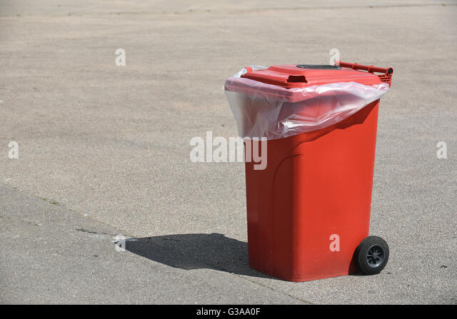 Red recycling bin - Stock Image